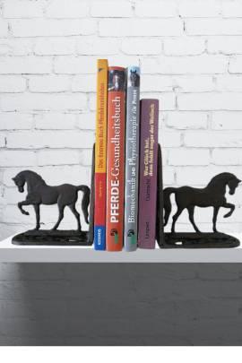 filigrane Buchstützen mit Pferden